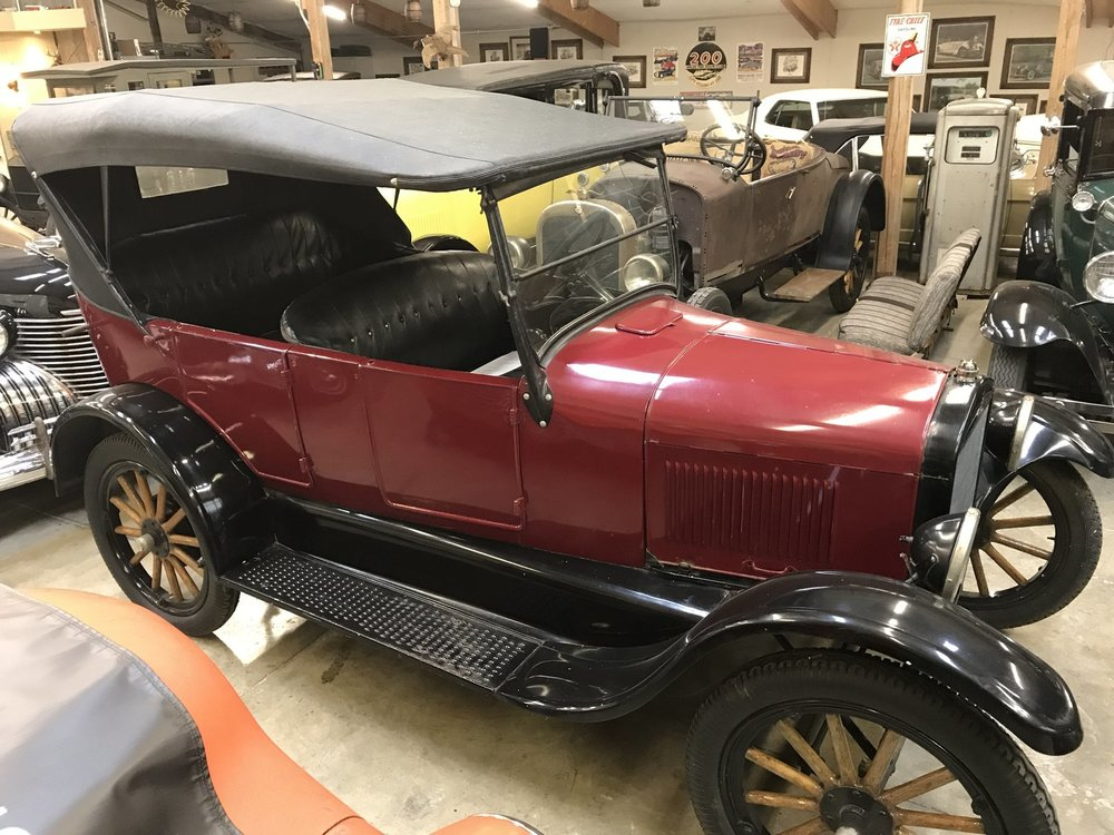 """1926 Ford Model T Touring<div class=""""price"""">$12,500</div>"""