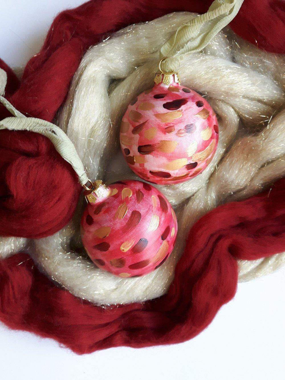 Flourishing Pointsettia Globe Ornament - $25.00
