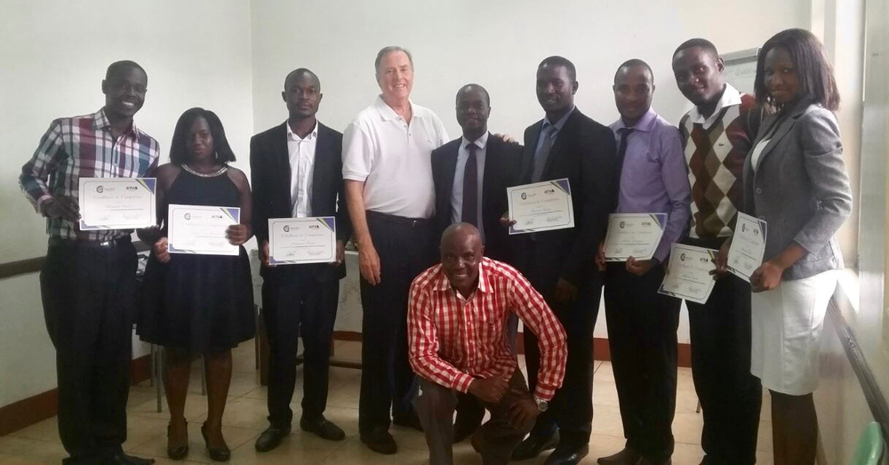 Our first graduates from a service center employee training class with Rick Whitaker, MD Global Operations and Abbey Kaddu, Project Coordinator