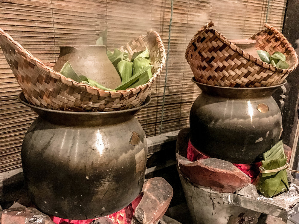 MOK PA, OR FISH IN BANAN LEAVES, IS STEAMED OVER A FIRE IN WOVEN BAMBOO BASKETS SIMILARLY TO STICKY RICE