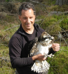 Keith Brockie with an osprey chick