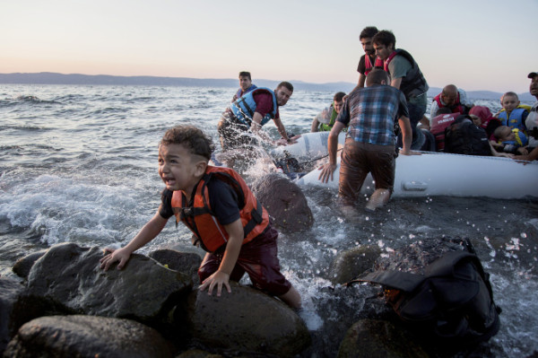A terrified child clings to a rock on the shore as a group of Syrian refugees arrive on the island after travelling by inflatable raft from Turkey. The Eastern Mediterranean route from Turkey to Greece has overtaken the central Mediterranean route, from North Africa to Italy, as the primary one for arrivals by sea. From January to June this year, 68,000 people arrived in Greece, compared with 67,500 in Italy, accounting for nearly all the arrivals in the period.