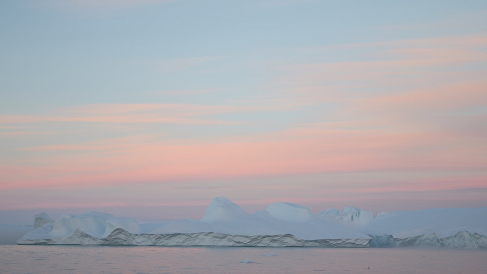 The midnight sun sets upon the Ilulissat Icefjord. Photo credit: Nancy Forde