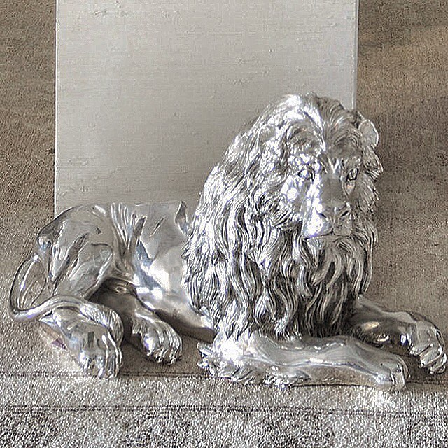"Only for the Bold and the Beautiful....sterling silver over gesso lion sculpture by Alessandro Magrino.  He is 24""x13""x10"" and heavy as lead.  He makes a statement anywhere he sits.  DM for more details. . . . #belleandburl #accessories #lion #sculpture #alessandromagrino #forsale #sterlingsilver #gesso #theboldandthebeautiful #heissotackyheisnt #italy #tuscany #hearmeroar #shiny #chachkis #amimals #style #heart #love #instagram #instagood"