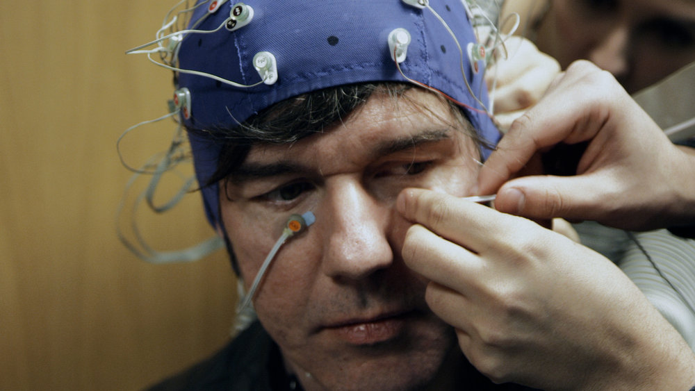 Neuroscientists at UVA ran preliminary tests to assess Stefan's well-being prior to undergoing three experimental trials designed to make him happier. Shown here, an EEG test is underway