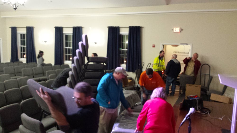 The night the chairs arrived for our new worship center in Sandown.