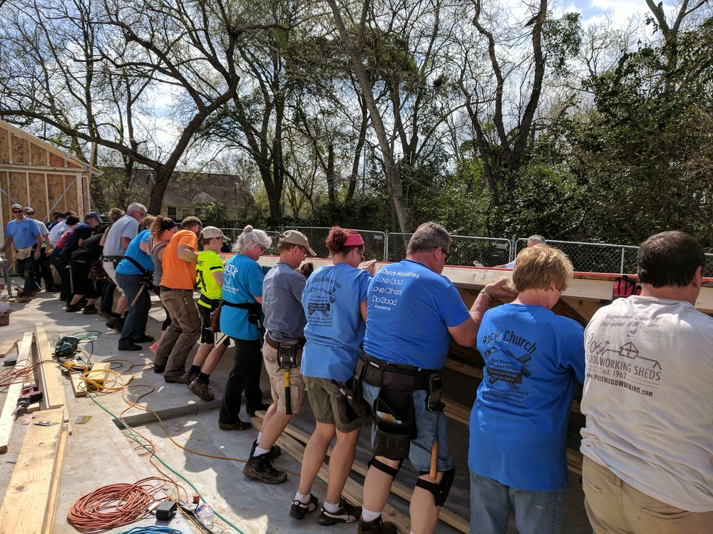 The Texas Mission Team raises one of the big walls.