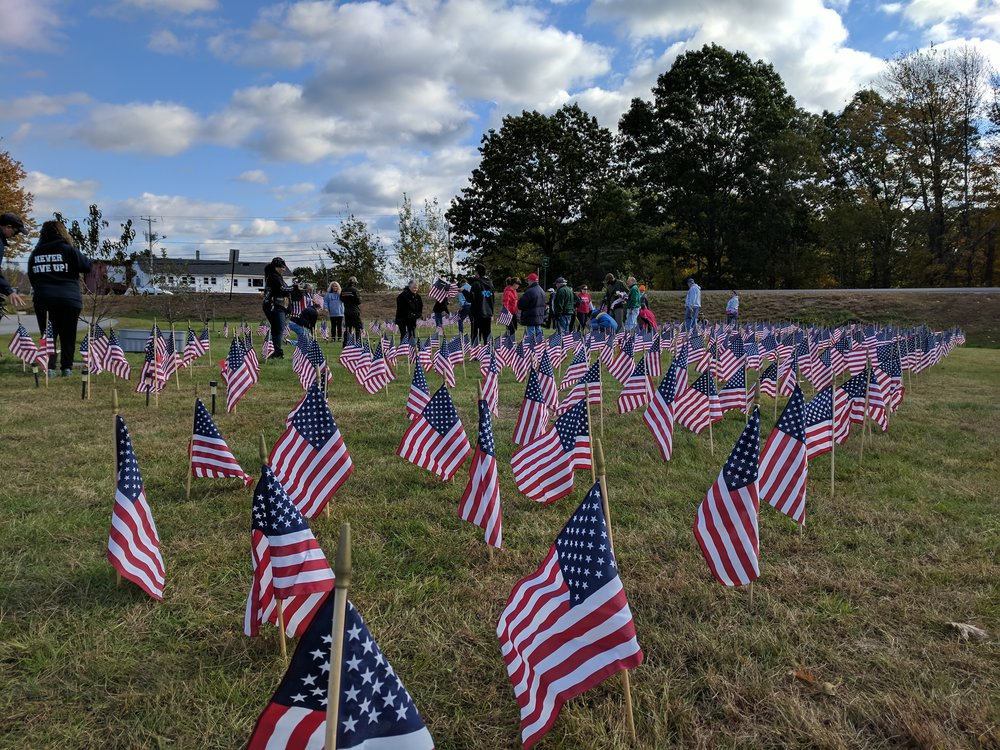 Weather permitting, we will be dismantling the field of flags this Saturday, Dec 1, beginning at 10:15 am. With a good group, we should be able to do it in 30 minutes. Join us if you can at our Plaistow location.