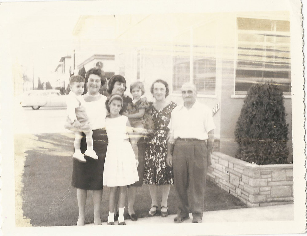 Sam and Jessie Townsley, and Townsley cousins, standing outside S. Holt Ave #3.