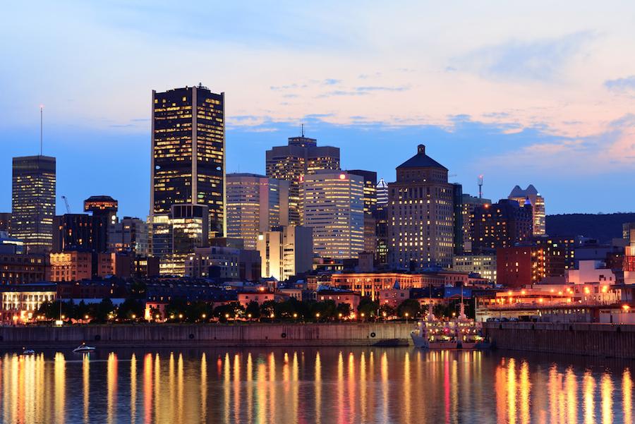 Photo:Montreal over river at sunset © Depositphotos.com/rabbit75_dep