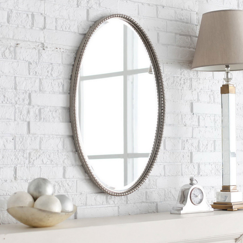 beautiful-oval-wall-mirror-with-metal-frame-on-white-brick-stone-wall-design-as-well-as-small-bathroom-vanity-plus-framed-bathroom-mirrors.jpg