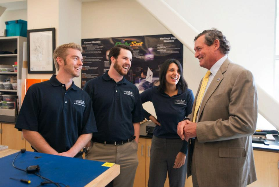 Derek Nelson, Nick Weiser, and Melody Golobic having a few laughs with the Chancellor.