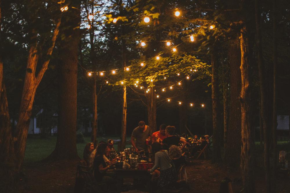 Evening gathering underneath beautiful string lights.  Photo Credit:Peter B Crosby