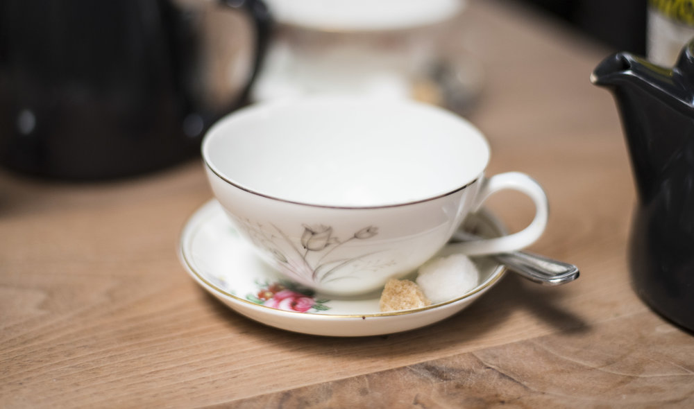 Tea is served in these pretty saucer cups.