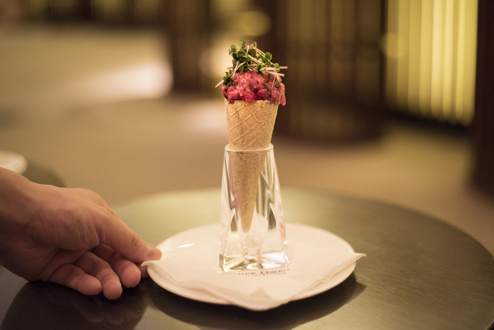 Beef tartar with mashed potatoes & cress in a Sancho-pepper-cone.