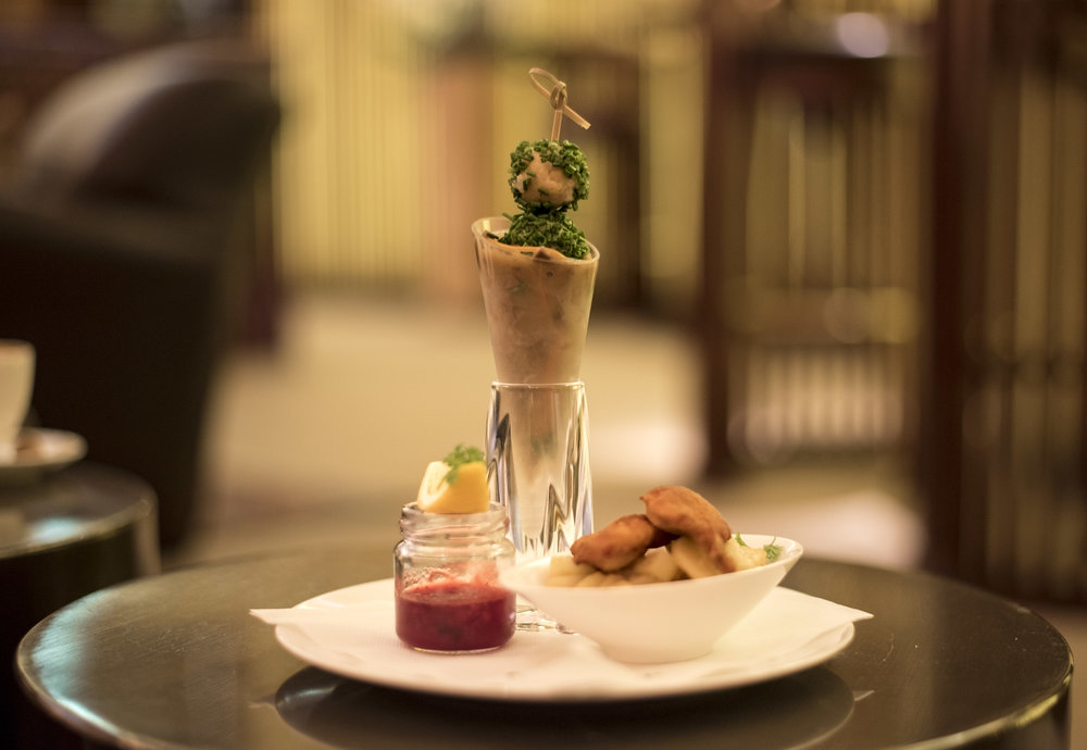 """Best of Austria"" in a glass-cone: Veal lights with chive dumplings / Wiener Schnitzel with potato salad"