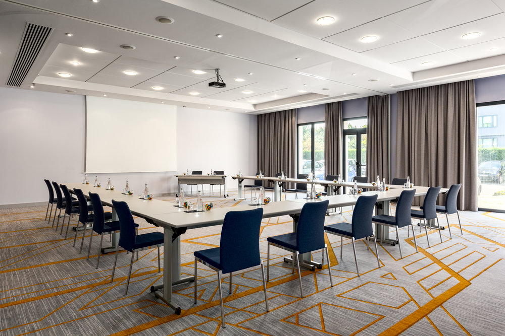 Custom designed carpets and furniture add vibrancy to the meeting rooms.