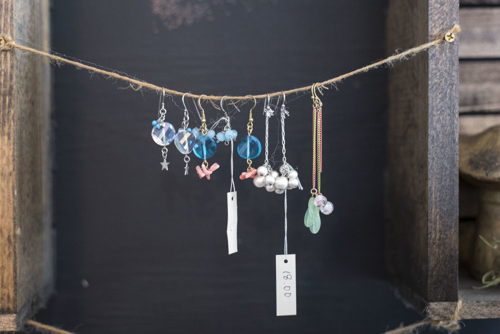 The shop also has a small section of retail goods, like the dainty earrings above and Kaimana branded cute tote bags and t-shirts.