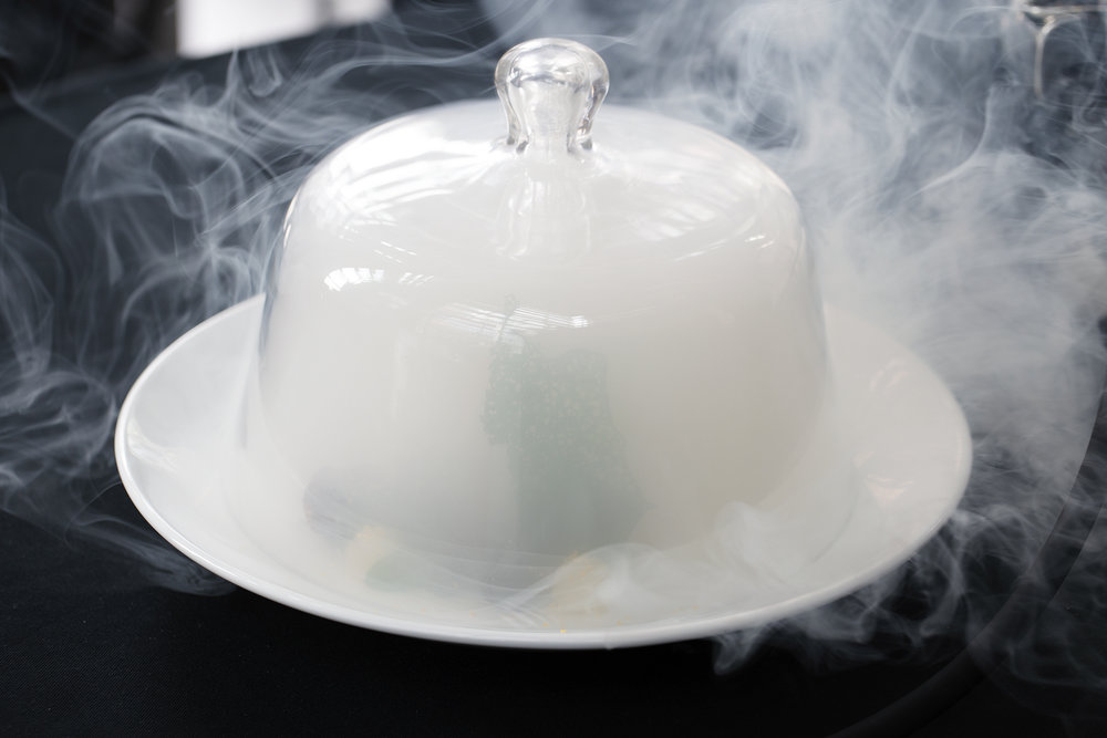 Smoking technique to infuse tea aromatics into the cooked octopus