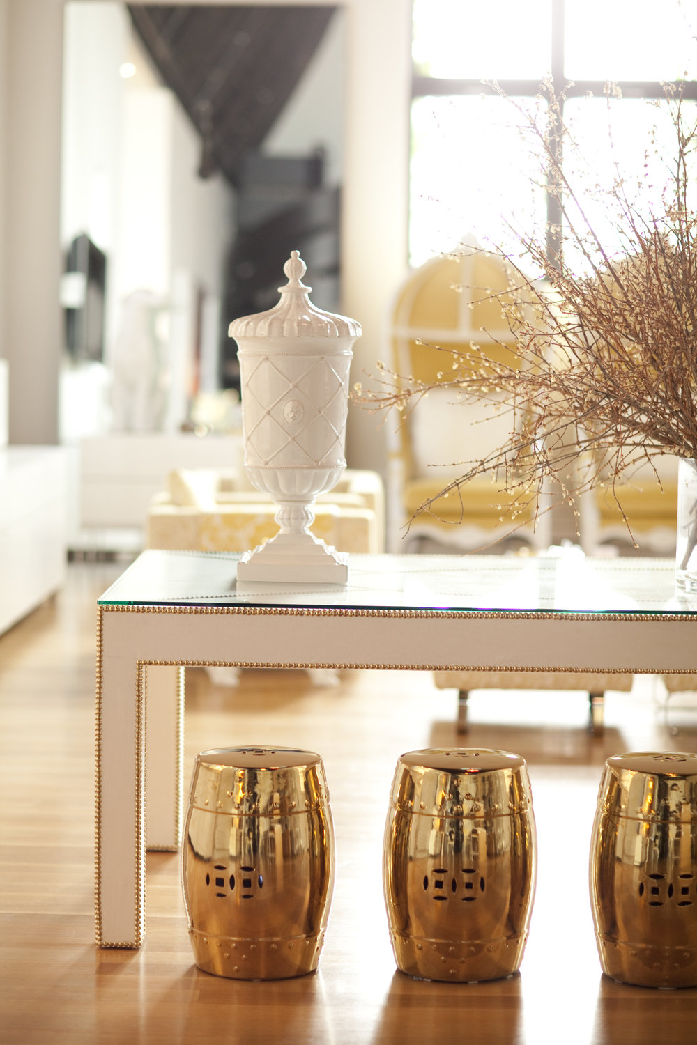 Gold, Chinese-inspired stools offer extra seating when guests are over.