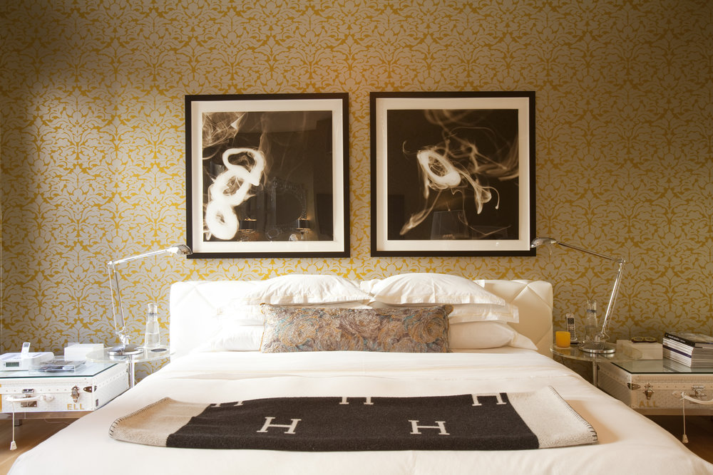 Couture inspired furniture pieces set the tone in the master bedroom.