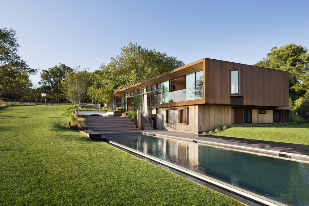 The house overlooks its 75-foot infinity edge lap pool that extends to the West.