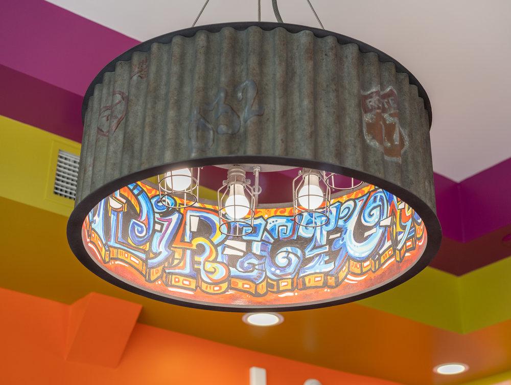 A light fixture with graffiti print.