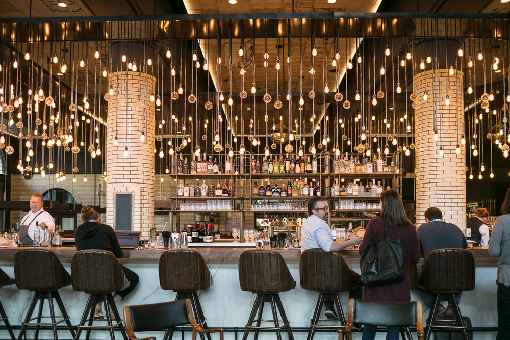 The restaurant bar is highlighted with hundreds of hanging bulbs.