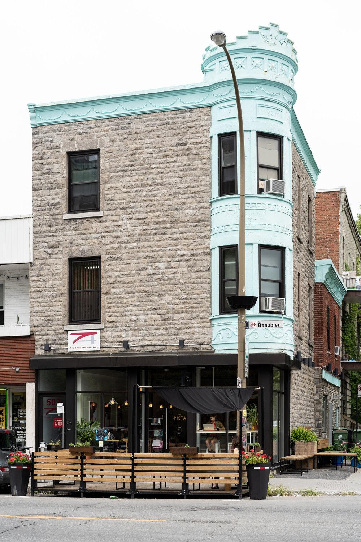 Mint-green exterior facade.
