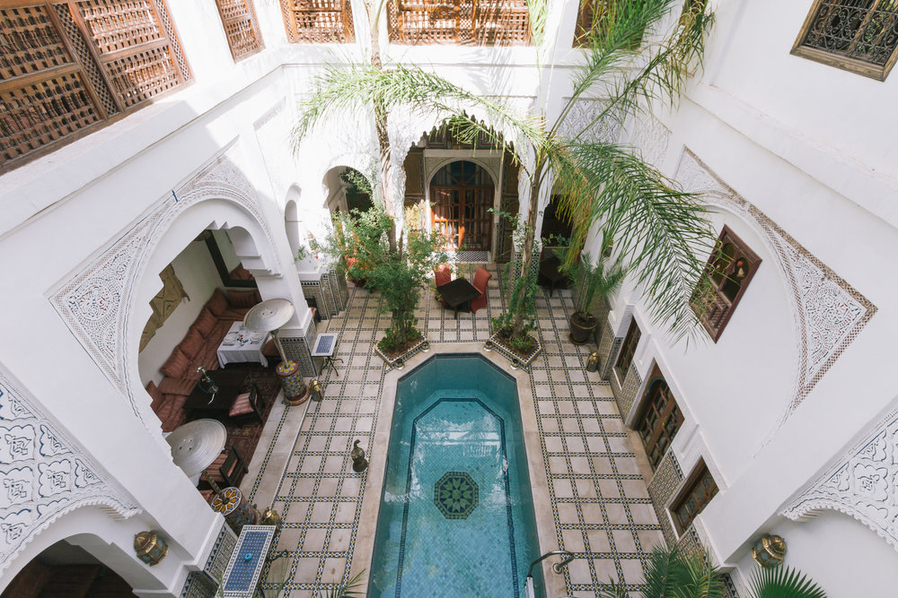 Central enclosed courtyard with a plunge pool at Esprit du Maroc.