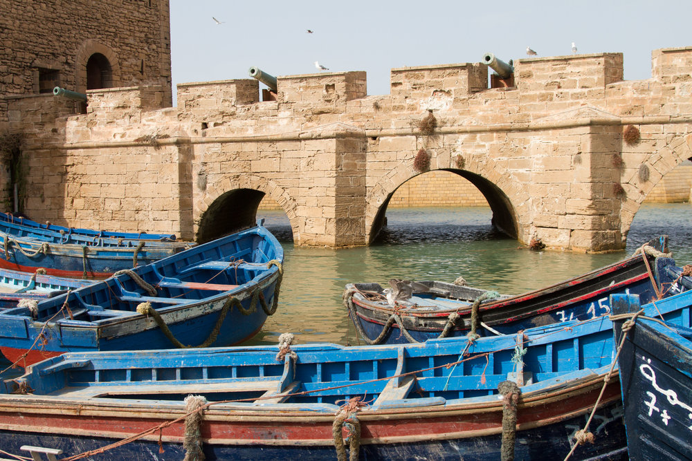 The iconic blue fishing boats and old port of Essaouira.