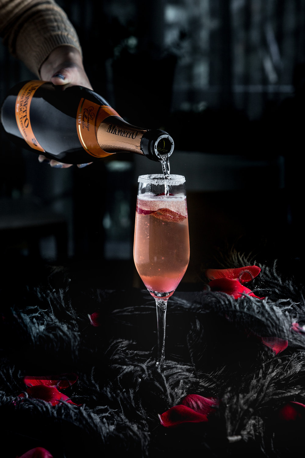 Black Rose. Truffle-infused SOV vodka, rose and strawberry syrup, topped with sparkling wine, sprayed with rose perfume.