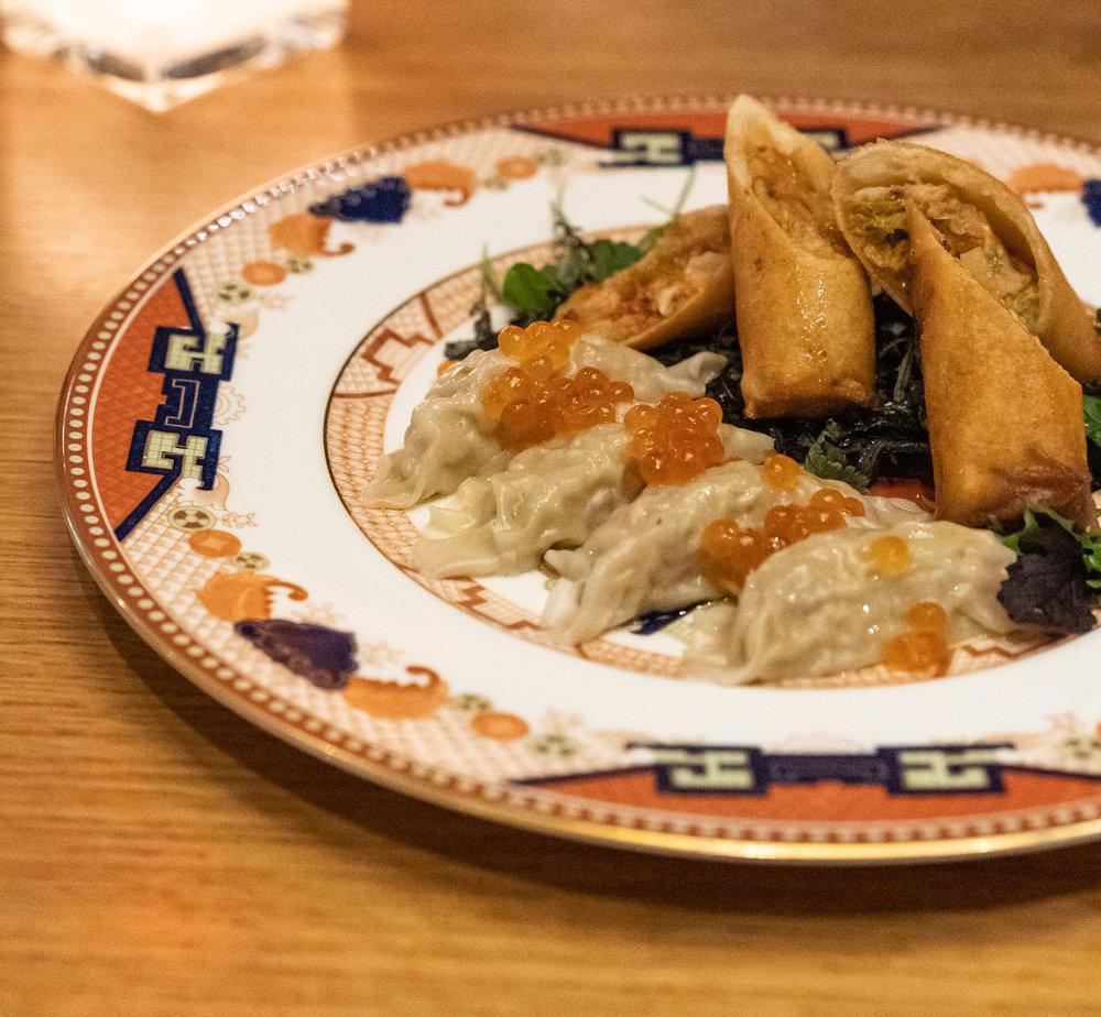 Scallop black truffle dumplings topped with shoyu ikura.