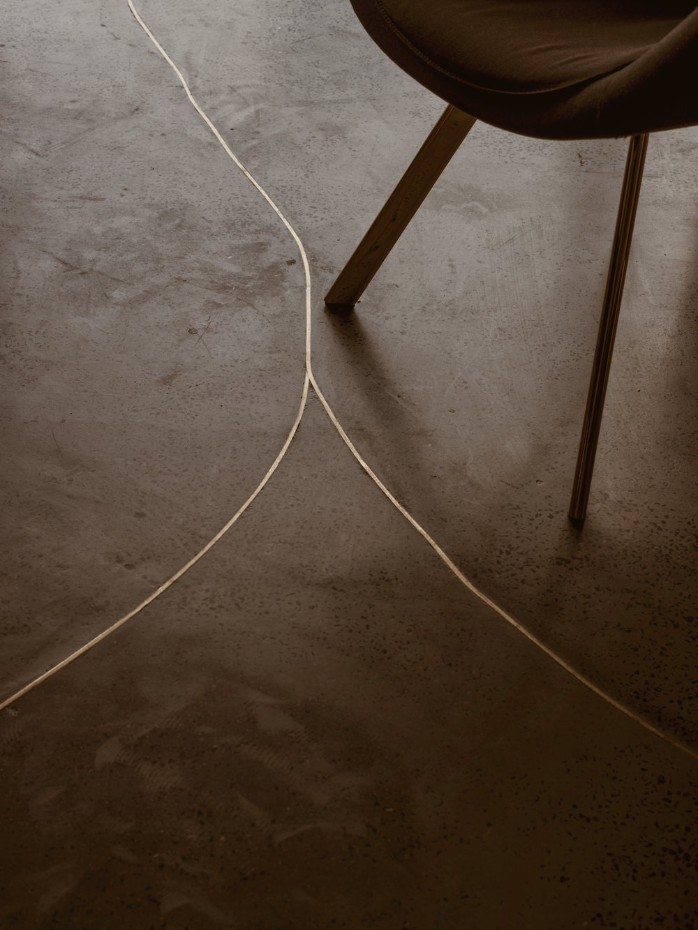 Cracks in the flooring are filled with brass inserts.