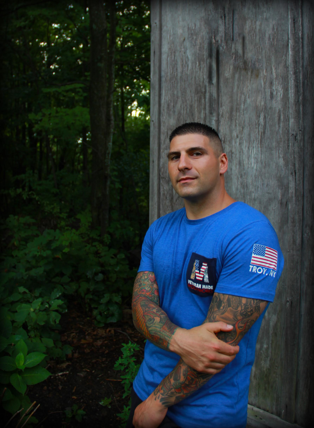 "Anthony Guadagnino  - Owner and Lead Carpenter  United States Marine Corps OIF Veteran and currently serving US Army SFC  This company was all started by a Thin Blue Line (TBL) Flag I thought up and created as a thank you gift for Ryan's help on a flooring job. Every veteran understands the brotherhood. Ryan and I served together in Iraq in 2003. We have remained friends ever since ***   fun fact:   We're close now, but we used to be rivals in high school football. As you can so obviously see in my picture compared to 'ole Ryan's here, I was definitely not the ""no tackle redshirt"" quarterback type like he was! BOOM! I got the last word in, RYAN!"