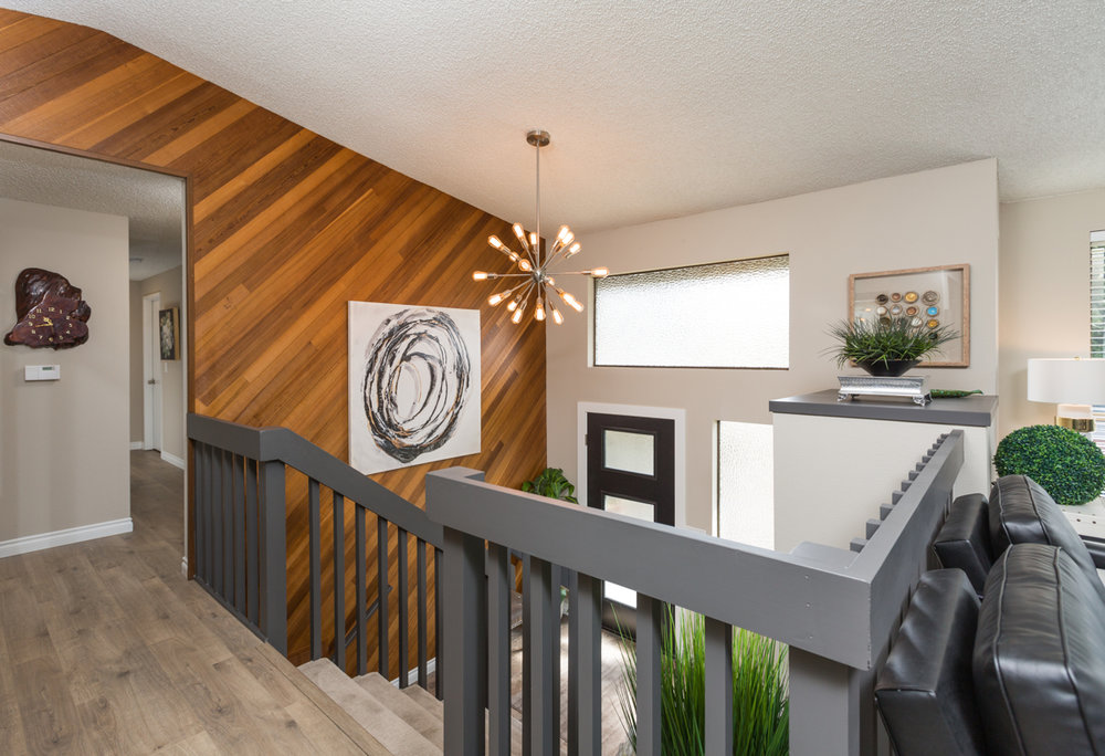 Enjoy the dramatic entrance of this home! Brand new flooring, contrasting new paint and impeccably designed layout.