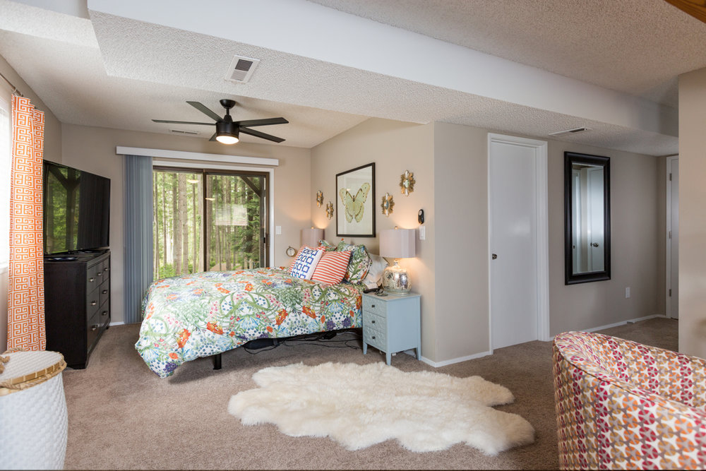 Believe it or not -- this is a secondary bedroom! It feels like a master suite all on its own! Imagine waking up every day and taking a few minutes to yourself on the easy-access back porch. Life will never be the same!