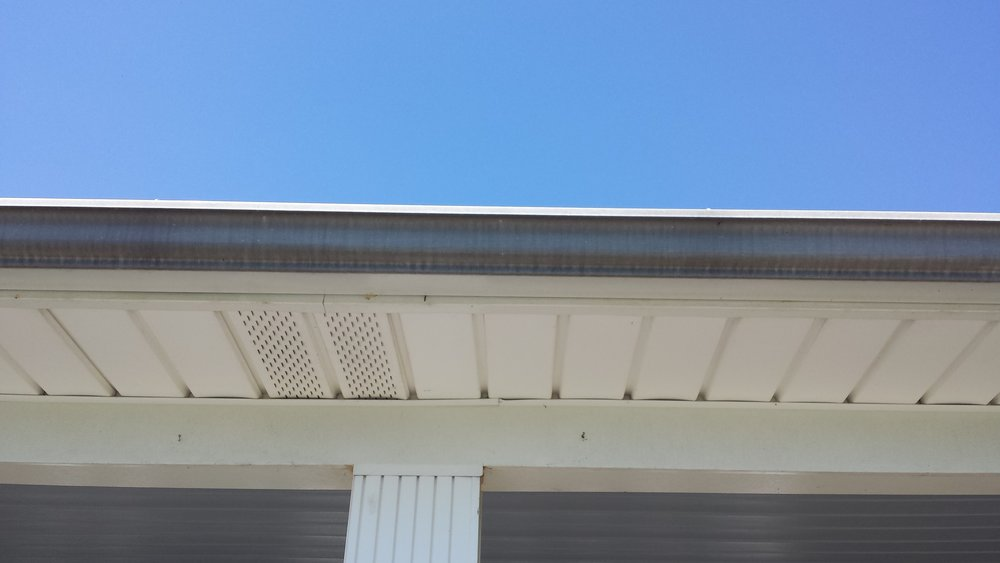 "Dark ""Tiger Stripes"" - Before.  Gutter Cleaning in Lexington North Carolina."