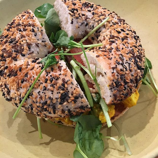Delicious turmeric cauliflower and watercress on a seeded bagel. They call it the Hippie-Slicker at @schmucksbagels in Melbourne. Just the right level of satisfying.