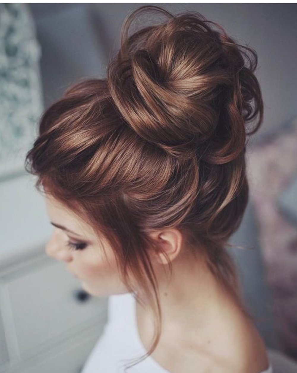 A cute top knot from  @brideallwedding