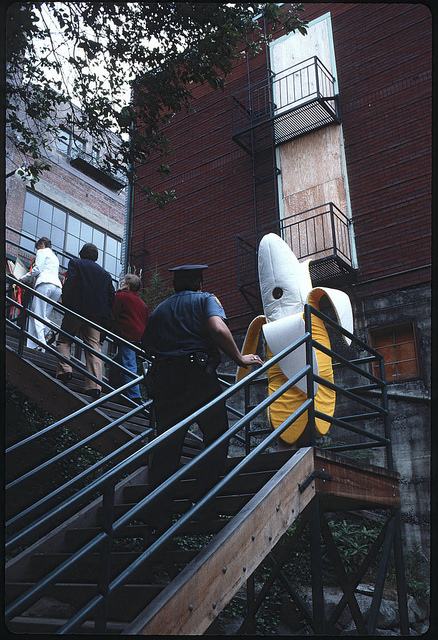Seattle Municipal Archives--Policeman and banana on Pike Place Market stairway, 1978