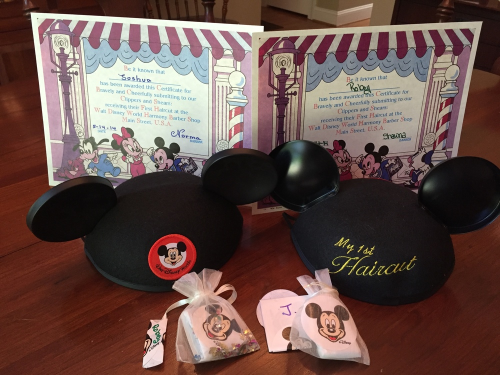"All this was included with the package - a certificate suitable for framing, a lock of their hair and some ""pixie dust"", and their very first set of Classic Mouse Ears!"