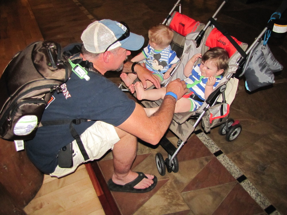 My husband Jim with our boys in May of 2014.  This was the day we got there; we stayed at Disney's Wilderness Lodge. They were totally mesmerized by the massive lobby in this resort!
