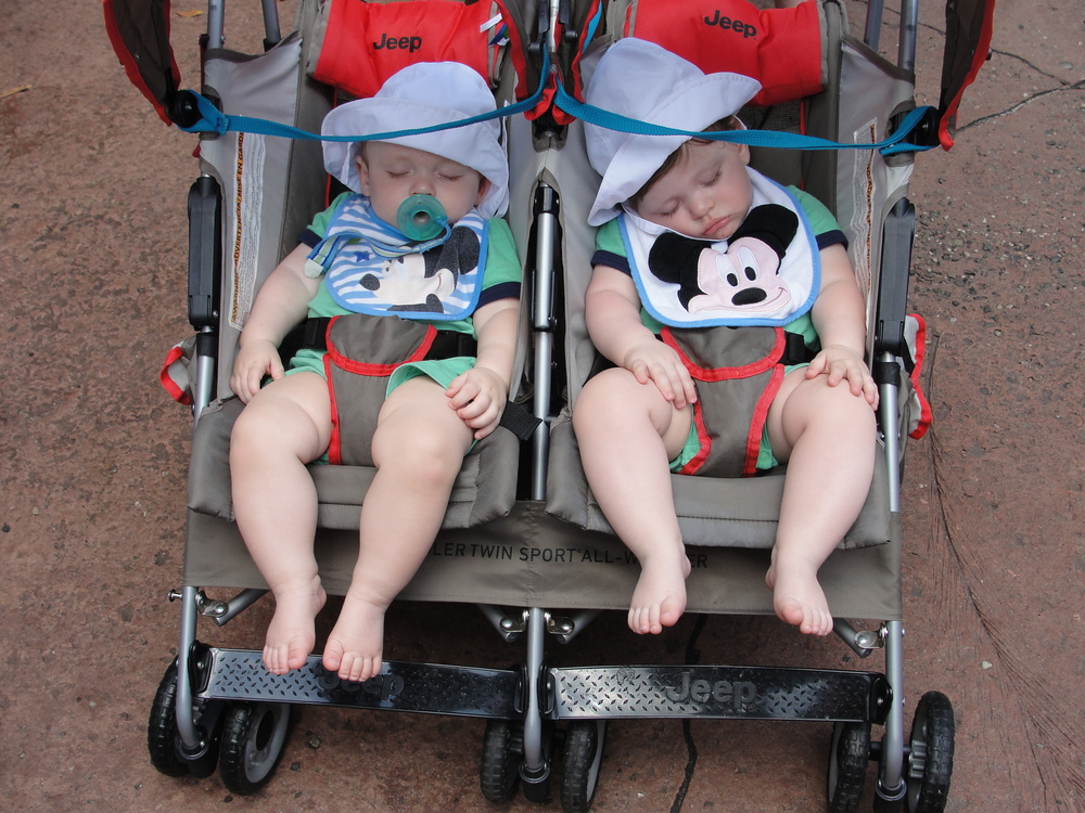 Choose a baby hat that is light or white in color so it's not too hot (bonus points if it has a chin strap to keep it from coming off)!  Our Jeep umbrella stroller was able to recline a little for the (many) times when the boys fell asleep being rolled around in the parks.