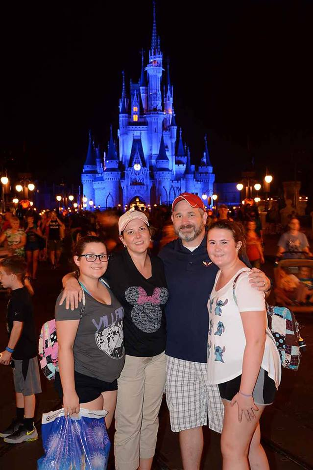 Dana H. & her family in front of Cinderella Castle