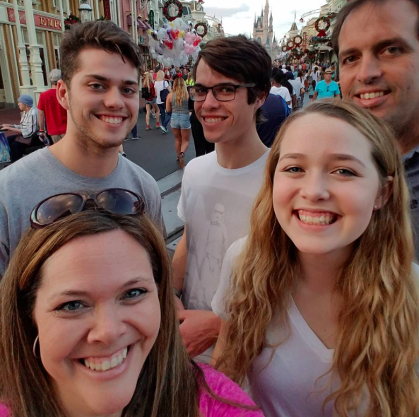 Kathleen V. and her family on Main Street, U.S.A. - a Christmas and Sweet 16 Birthday Celebration for her daughter!