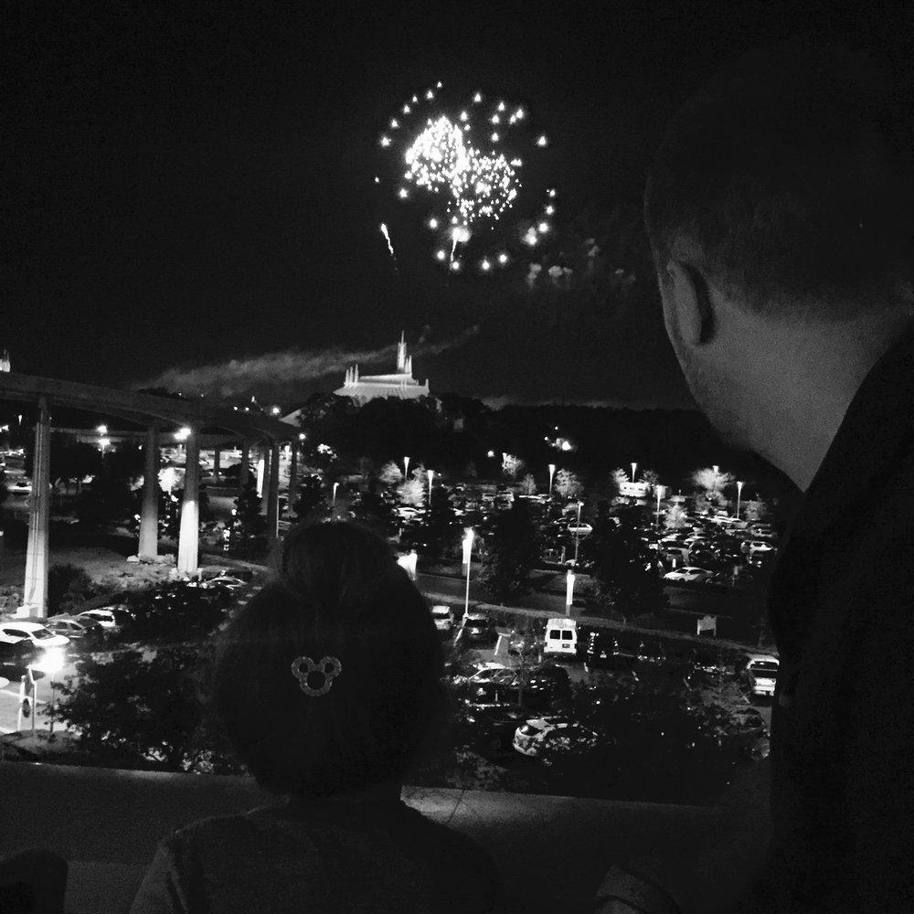 Danielle T.'s daughter and husband enjoy the view of the fireworks from their resort hotel room at Disney's Contemporary Resort