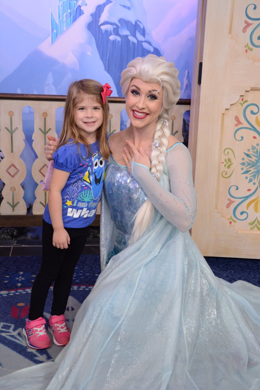 Carey B.'s daughter meets Elsa at the Royal Sommerhus in  Epcot®