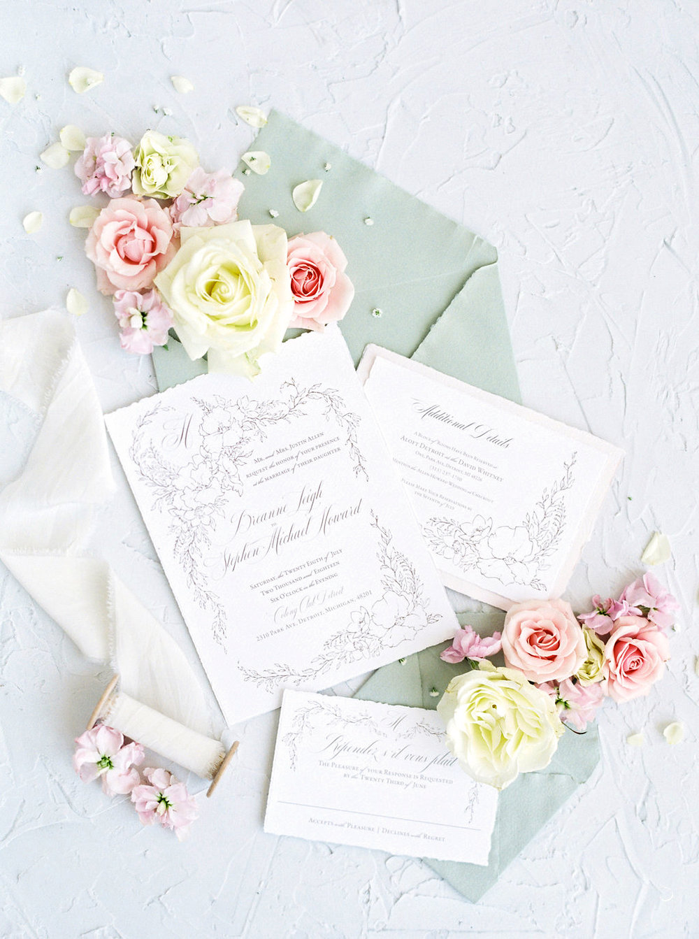 Handmade paper wedding invitations with floral illustration and fine art details.  Italian paper featuring a custom monogram in the corner of a hand illustrated wedding stationery suite.  Blushed Design: Wedding Invitations and Fine Art Portraits