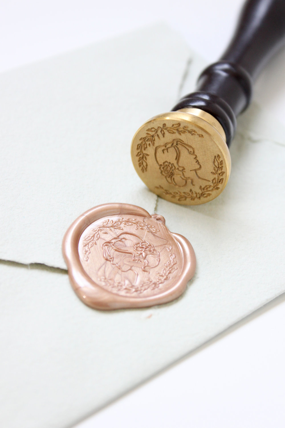 "How to use wax seals.  Stamp wax seals like a pro with these tips from professional fine art stationer, Katrina Crouch! Rose gold wax featuring the ""Blushed Bride"" seal exclusively at Artisaire.com 